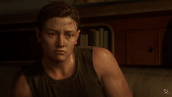 Abby from The Last of Part Two looking solemn. She wears a vest top and her blonde hair is in a plait.