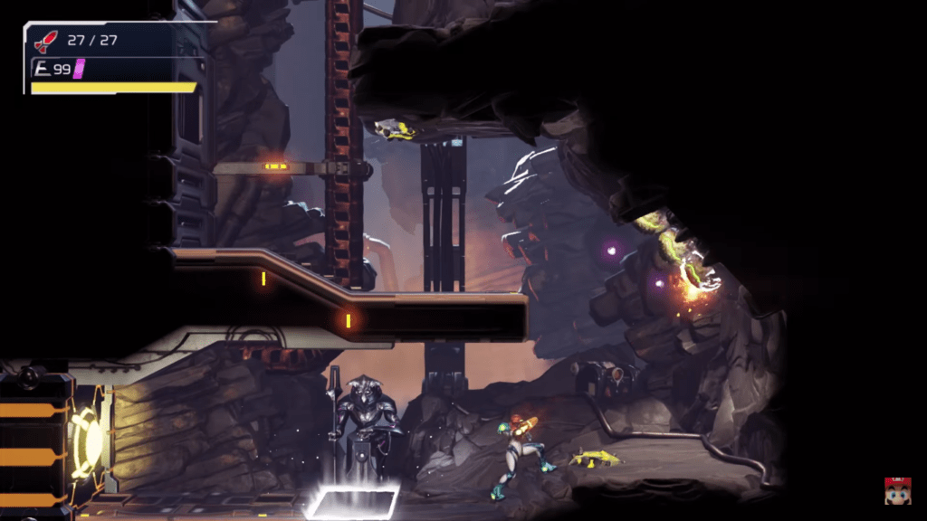 2D platformer Metroid Dread shows Samus at the bottom of the screen shooting at an enemy to the right, there is a platform above her and the background is made up primarily of rocks and metal.