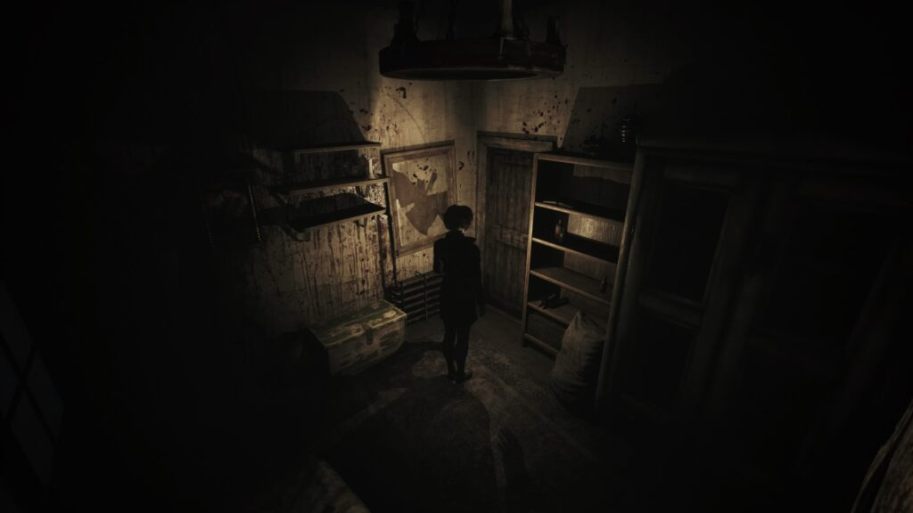Woman in a dark room facing a door, the room appears to be in disarray with blood on the walls and smashed mirrors
