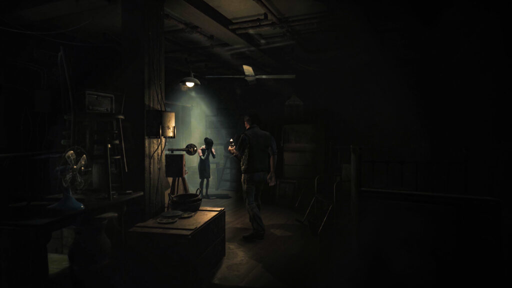 Still from Song of Horror, a man approaches a girl who has her hands over her face in a dimly lit attic filled with odds and ends, he is holding a candle and there is a spotlight on the girl.